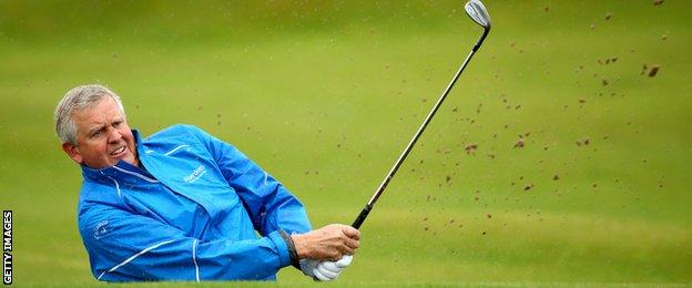 Colin Montgomerie plays out from the bunker during the third round of the 2014 Alfred Dunhill Links Championship