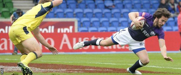 Colin Gregor scores a try for Scotland during the Glasgow Sevens
