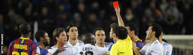 Real Madrid's Sergio Ramos is shown the red card by referee Iturralde Gonzalez