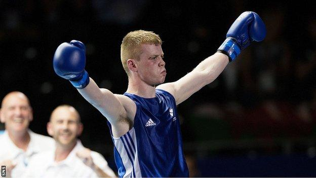 Charlie Flynn celebrates after beating Joe Cordina in the Commonwealth Games