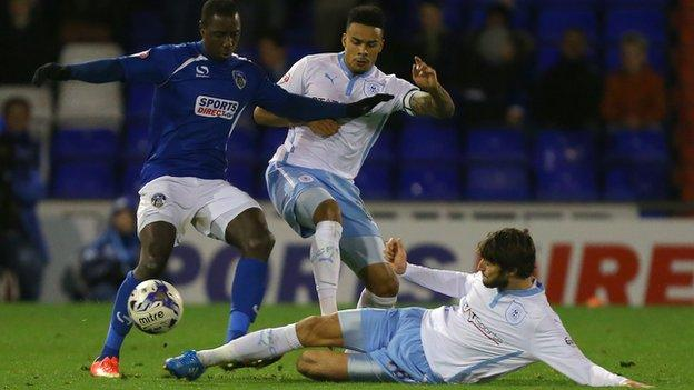 Jonathan Forte is tackled by two Coventry players at Boundary Park