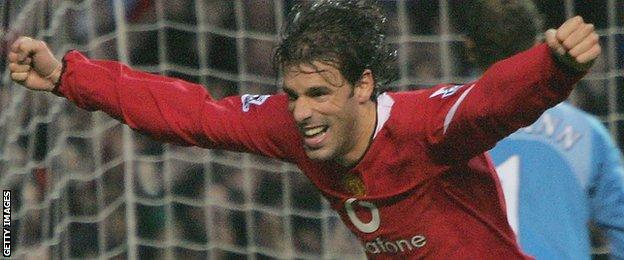Ruud Van Nistelrooy peels away in celebration after scoring from the penalty spot against Arsenal