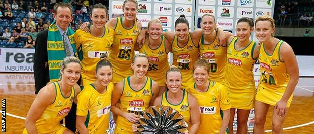 The Australia team pose with the series trophy