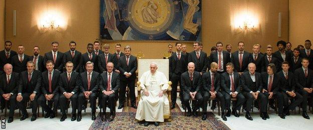 Bayern Munich players presented Pope Francis with a signed shirt during a private audience on Wednesday