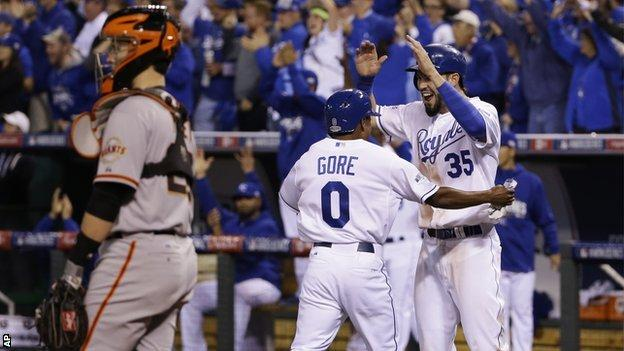 Terrance Gore celebrates with Royals team-mate Eric Hosmer after scoring a double in the sixth inning