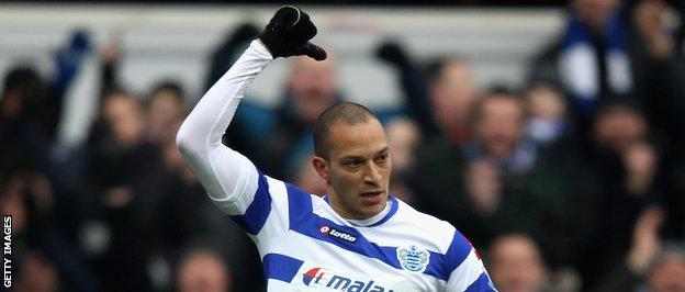 Bobby Zamora points to the name on the back of his shirt