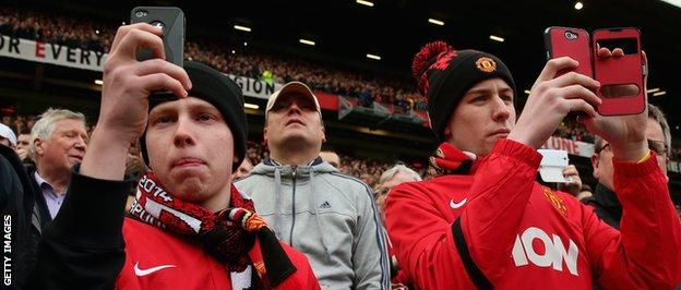 Manchester United fans film action on their camera phones