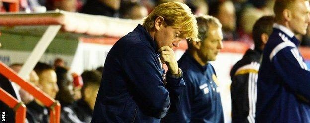 Motherwell manager Stuart McCall looks pensive in the dugout