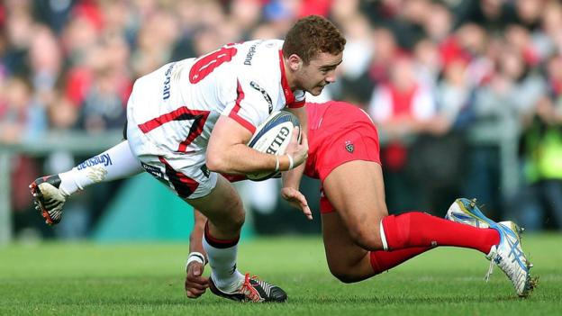 Ulster fly-half Paddy Jackson tries to evade a tackle from Maxime Mermoz