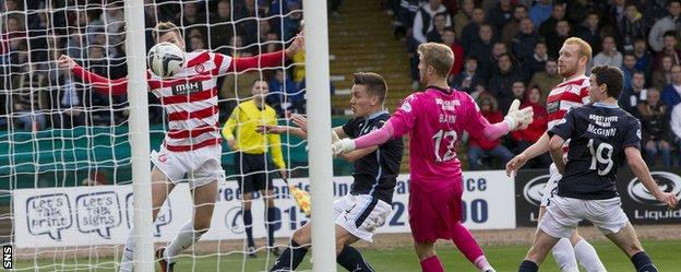 Michael Devlin can only head into the side netting as Hamilton are frustrated on their trip to Dens Park
