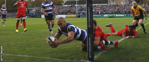 Olly Woodburn is tackled by Vincent Clerc