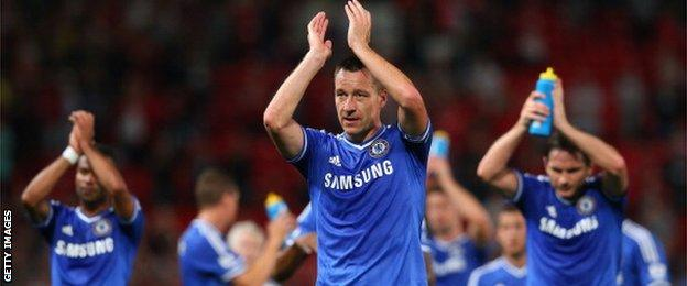 John Terry applauds the Chelsea fans at Old Trafford after a 0-0 draw in 2013