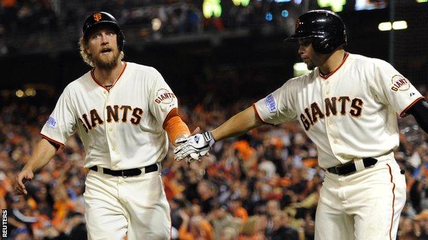 Hunter Pence (left) celebrates after scoring a run for San Francisco Giants