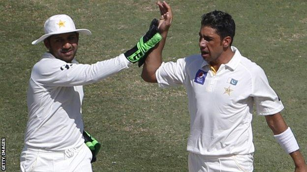 Pakistan's Sarfraz Ahmed and Imran Khan celebrate the dismissal of Australia's Chris Rogers