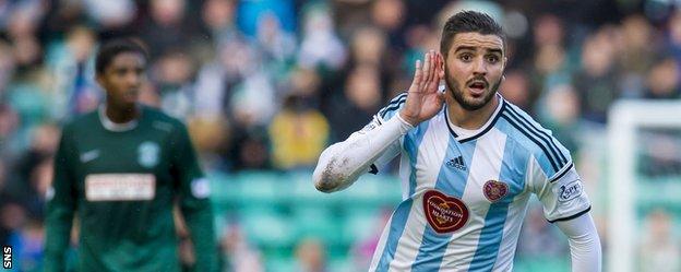 Alim Ozturk celebrates after scoring for Hearts against Hibernian