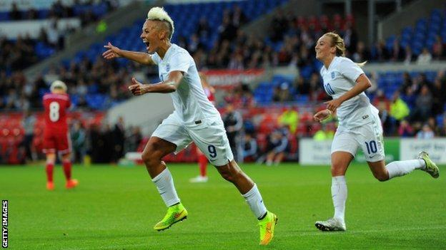 England Women's striker Lianne Sanderson celebrates scoring against Wales.