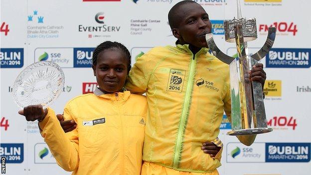 Kenyan duo Esther Macharia and Eliud Too celebrate their Dublin Marathon success