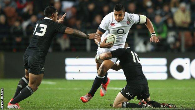 Luther Burrell is tackled by Aaron Cruden