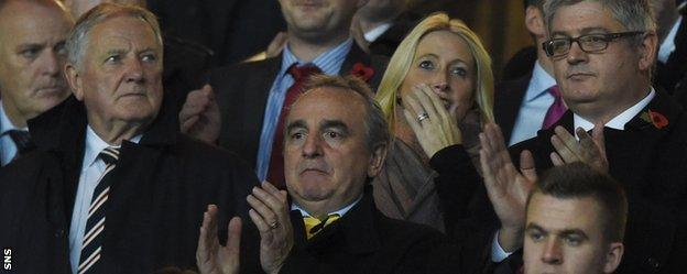Former Newcastle United manager director Derek Llambias (centre) in the stand after becoming a Rangers consultant