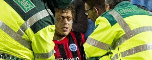 St Johnstone midfielder Murray Davidson is treated for an eye injury
