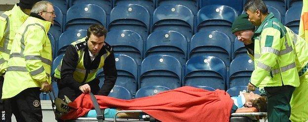 Rangers goalkeeper Steve Simonsen is stretchered off