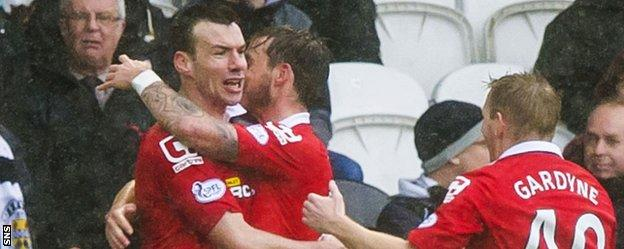 Paul Quinn (left) celebrates scoring for Ross County against St Mirren
