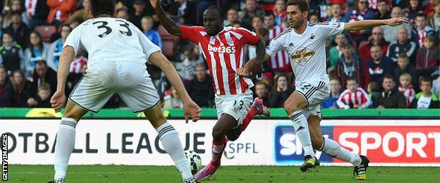 Victor Moses of Stoke is challenge by Swansea's Angel Rangel, who conceded a penalty.