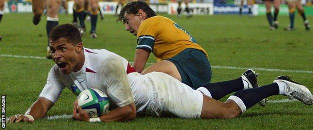 Jason Robinson celebrates a try in England's 2003 World Cup final win over Australia