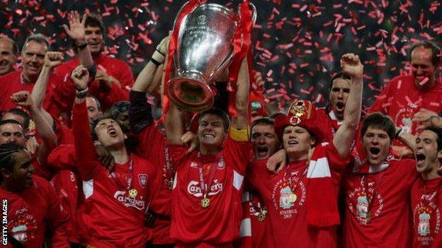 Liverpool captain Steven Gerrard holds the European Cup aloft