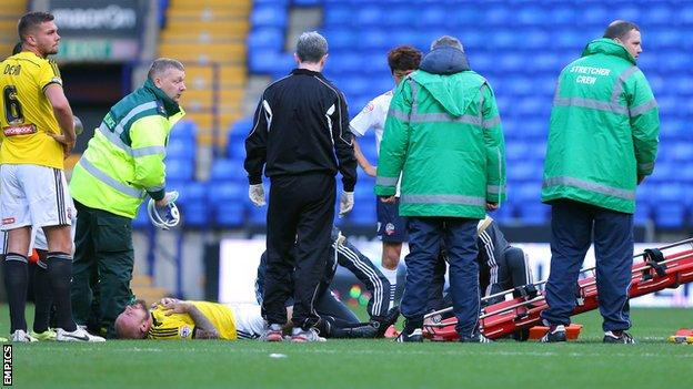 Alan McCormack (third from left) was stretchered off with an ankle injury at Bolton
