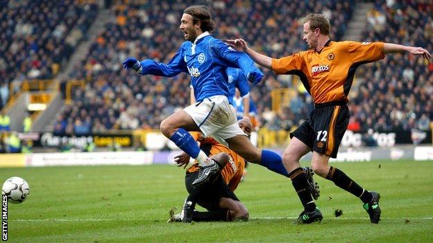 Blues striker Christophe Dugarry tangles with Wolves defender Jody Craddock, Molineux (November 2003)