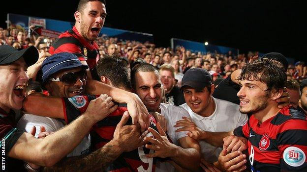 West Sydney Wanderers players celebrate with fans