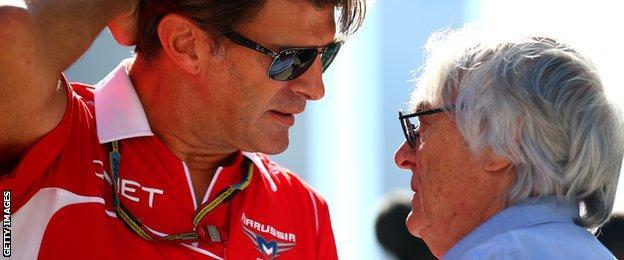 Bernie Ecclestone talks to Graeme Lowdon in Sochi