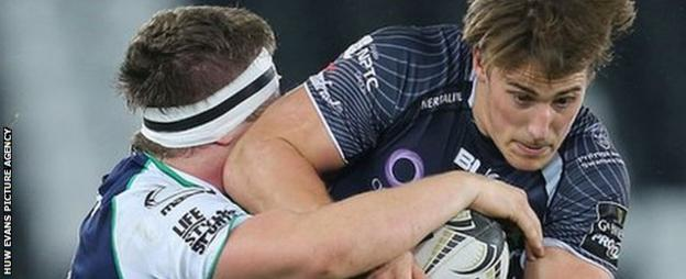 Ospreys' Jeff Hassler is tackled by Connacht's Jason Harris-Wright