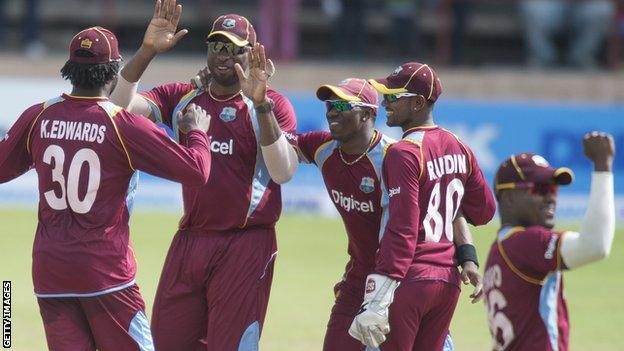West Indies one-day captain Dwayne Bravo (second left) leads celebrations