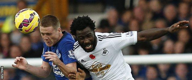 Everton midfielder James McCarthy (left) and Swansea striker Wilfried Bony