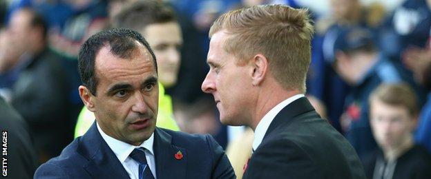 Everton manager Roberto Martinez (left) and Swansea boss Garry Monk