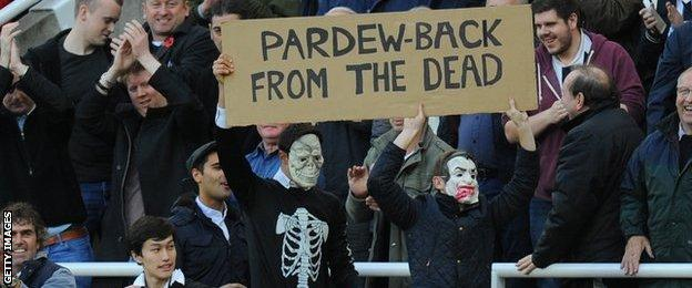 Newcastle fans with a 'Pardew - back from the dead' banner
