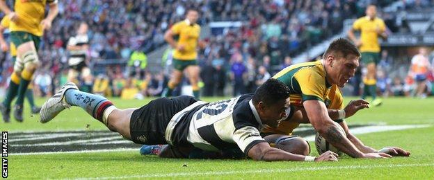 Francis Saili of the Barbarian beats Sean McMahon to the ball to score a try