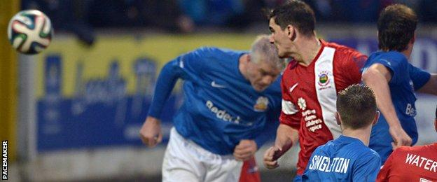 Jimmy Callacher heads in Linfield's winner in the Premiership match at Glenavon