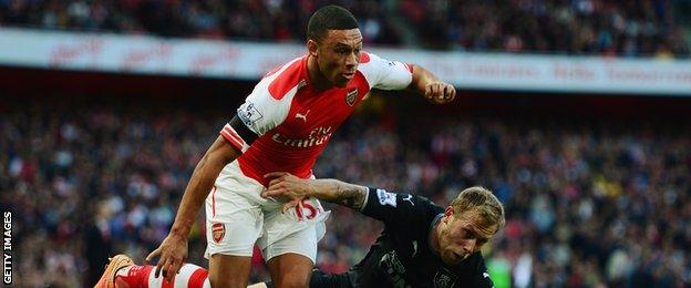 Alex Oxlade-Chamberlain is tackled by Burnley's Scott Arfield