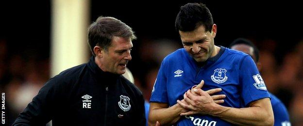 Everton defender Antolin Alcaraz goes off injured against Swansea