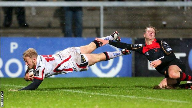 Stuart Olding gets ahead of Angus O'Brien to go over for his first try against the Dragons