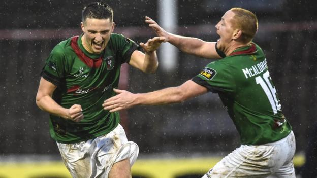 Jim O'Hanlon is congratulated by team-mate Stephen McAlorum after scoring the opening goal in Glentoran's 4-0 Irish Premiership win over Ballymena United