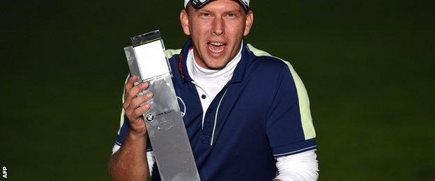 Marcel Siem with the BMW Masters trophy