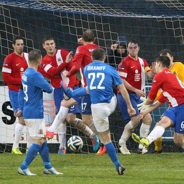 Kevin Braniff scores Glenavon's goal after a disputed free-kick award in the match against Linfield