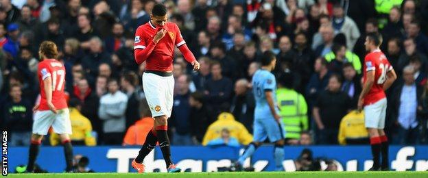 Chris Smalling walks off after being sent off in the Manchester derby