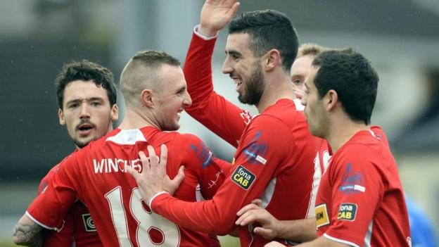 Joe Gormley celebrates with team-mates after scoring for league leaders Cliftonville at Dungannon Swifts