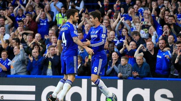 Chelsea players Cesc Fabregas (left) and Oscar celebrate a goal in the game against QPR