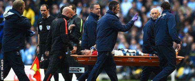 Marcos Rojo is stretchered off at the Etihad Stadium
